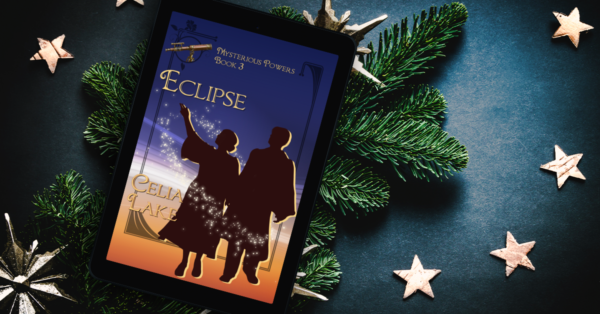 An ereader displaying the cover of Eclipse lies on a bed of pine boughs, surrounded by scattered gold stars. The twilight blue and gold cover shows a silhouetted man and woman, the woman's hand reaching up to point at something in the sky. A small telescope is inset in the top left and the figures are circled by stars.