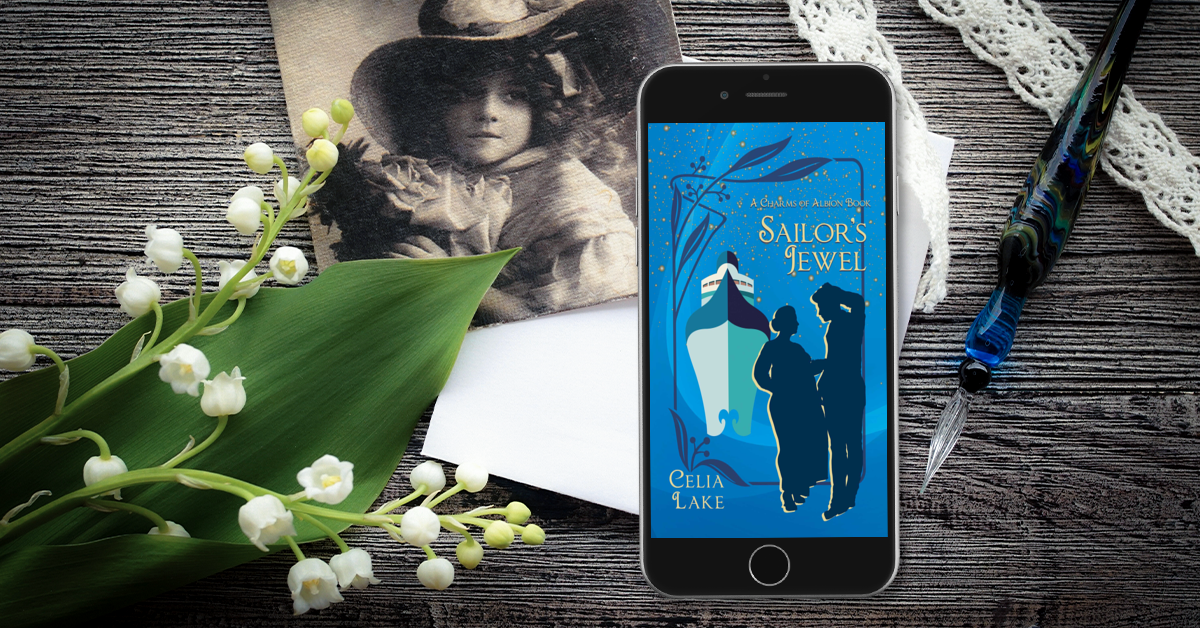 Sailor's Jewel cover displayed on a phone sitting on a wooden esk with a spray of lily-of-the-valley, a glass dip pen, and an antigue sepia-tone photo of a girl with girls in a broad-brimmed hat. The cover shows a silhouetted man and woman on a bright blue background, with an ocean liner facing out at the viewer.